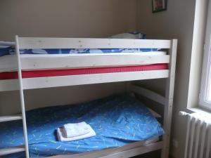 Un ou plusieurs lits superposés dans un hébergement de l'établissement Residence L'Etoile du Sancy