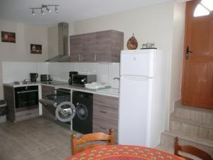 Cuisine ou kitchenette dans l'établissement Residence L'Etoile du Sancy