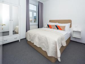 Een bed of bedden in een kamer bij Dolac One Apartments