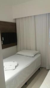 A bed or beds in a room at Flat Recife Hotel & Convention