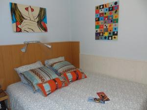 A bed or beds in a room at Apartamento Fernando