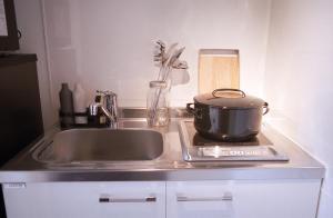 アートマンションAOCA山王2B 流水にあるキッチンまたは簡易キッチン