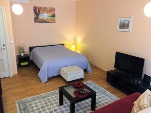Voodi või voodid majutusasutuse Romeo Family Apartments toas