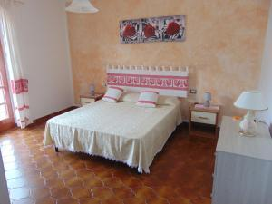 A bed or beds in a room at Appartamenti Budoni