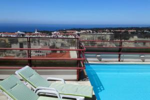 The swimming pool at or near Spacious Cascais Apartment with Rooftop Pool