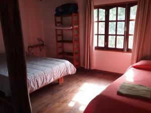 A bed or beds in a room at El Alamo