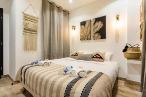A bed or beds in a room at CMG Gambetta