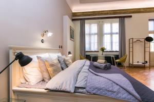 Postel nebo postele na pokoji v ubytování Apartman Nebovidy