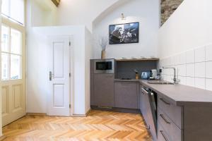 Kuchyň nebo kuchyňský kout v ubytování Apartman Nebovidy