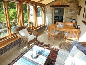 A seating area at The Garden Cottage, Weymouth