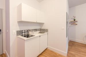 A kitchen or kitchenette at Apartment WS Hôtel de Ville - Musée Pompidou