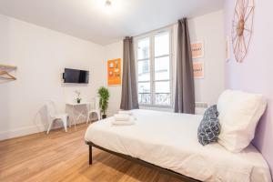 Un ou plusieurs lits dans un hébergement de l'établissement Apartment WS Hôtel de Ville - Musée Pompidou