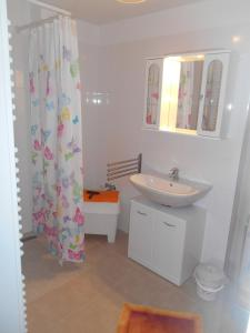 A bathroom at Nordrand-Apartment