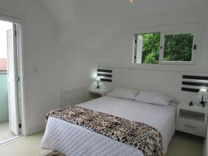 Cama ou camas em um quarto em San Clemente Residence