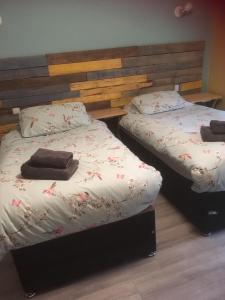 A bed or beds in a room at Lincoln Self Catering
