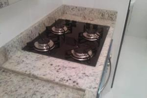 A kitchen or kitchenette at Apartamento novo Poços de Caldas