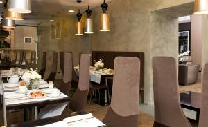 Um restaurante ou outro lugar para comer em Palazzo Al Velabro