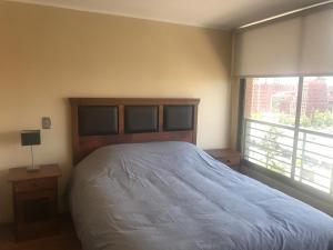 Cama o camas de una habitación en Estupendo Departamento Escuela Militar