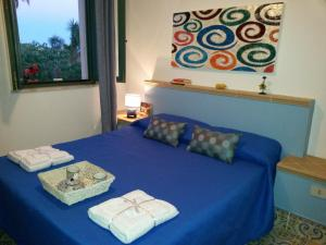 A bed or beds in a room at Marinella Selinunte's home