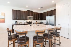 A kitchen or kitchenette at Encore Resort 2047 6 Bedroom Water Park