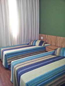 A bed or beds in a room at Park Flat Savassi