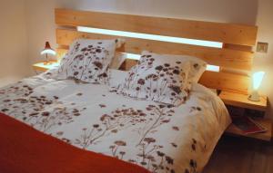 Un ou plusieurs lits dans un hébergement de l'établissement Gite urbain AU 2BIS