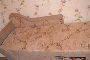 Кровать или кровати в номере Apartament na Flotilya
