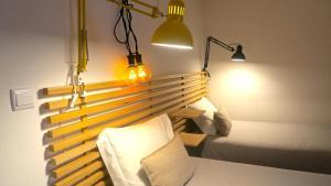Posteľ alebo postele v izbe v ubytovaní 99 Colored Socks