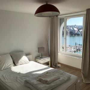 Un ou plusieurs lits dans un hébergement de l'établissement Pleine Vue Mer Port