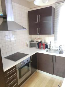 A kitchen or kitchenette at Hispalis Ayuntamiento
