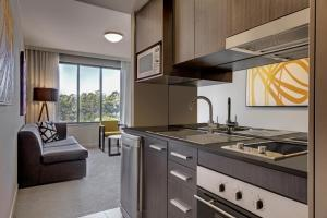 A kitchen or kitchenette at Adina Apartment Hotel Norwest Sydney
