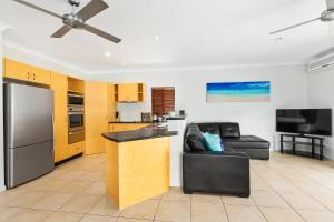 A kitchen or kitchenette at Private Large Cairns Family Home, Rainforest Views