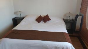Una cama o camas en una habitación de Apart Dry Fly