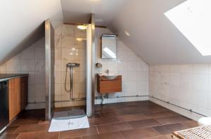 A bathroom at Cozy Apartment