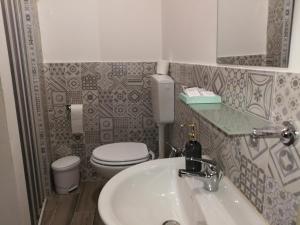 Ein Badezimmer in der Unterkunft Casa Le Coccole