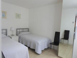 A bed or beds in a room at 202 Apartments