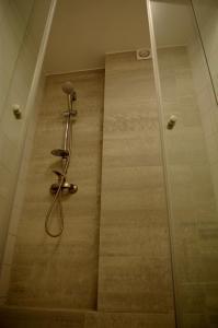 Vonios kambarys apgyvendinimo įstaigoje Perfect Apartments