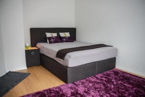 Ein Bett oder Betten in einem Zimmer der Unterkunft Apartments in Bern - Breitenrainplatz