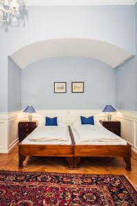 Ein Bett oder Betten in einem Zimmer der Unterkunft Ofenloch Apartments