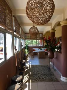 A restaurant or other place to eat at Bolo Residence Douala