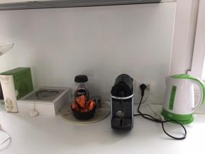 Set per la preparazione di tè e caffè presso Natural Home Apartment