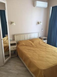 Кровать или кровати в номере Apartment Meridian Dagomys