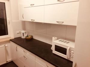 مطبخ أو مطبخ صغير في Blue apartment