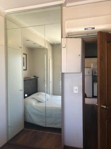 Una cama o camas en una habitación de Mitre Recoleta