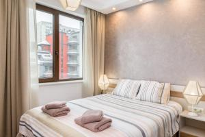 A bed or beds in a room at *M&M* Modern & Multifunctional One Bedroom Apartment