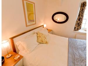 A bed or beds in a room at Sand Dune