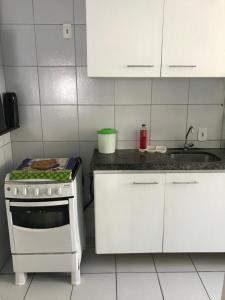 Kuchyň nebo kuchyňský kout v ubytování Apartamento Augusto Lucena
