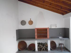 A kitchen or kitchenette at Casinha dos Avós