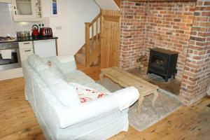 A seating area at Inglenook Cottage