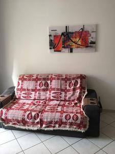 A seating area at Apartamento Perto de Tudo